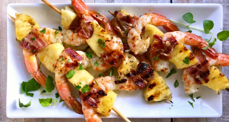 Juicy pineapple and crisp bacon surround chunks of succulent shrimp in this low carb Bacon Pineapple Shrimp Skewers recipe. Perfect for summer!
