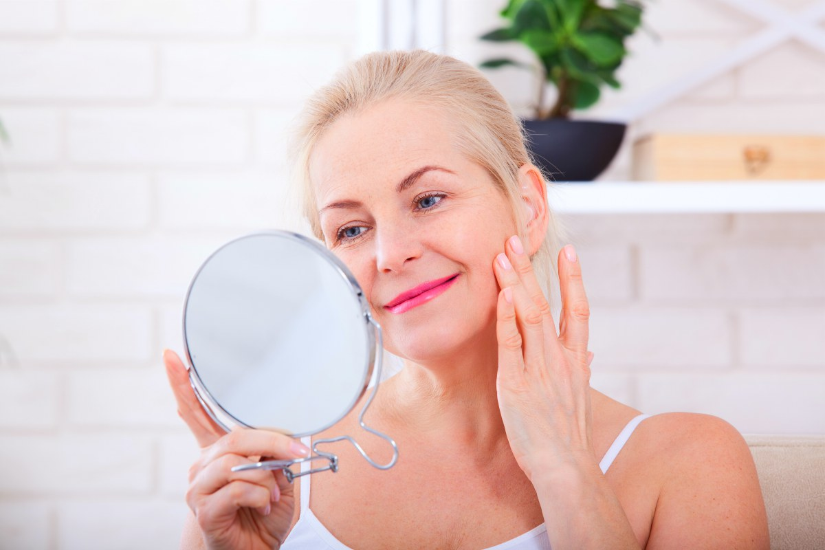 senior woman looking in the mirror | Argireline: Reduce Wrinkles With Famous 'Botox in a Jar' (How It Works) | argireline | argireline cream