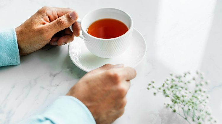 person holding cup of tea | BRAIN TEA: Teas To Drink That Boost Brain Health | brain tea | herbs to improve memory | Featured
