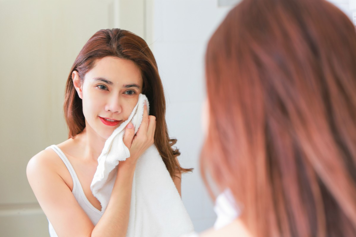woman wiping her face with towel | Argireline: Reduce Wrinkles With Famous 'Botox in a Jar' (How It Works) | argireline | argireline products over the counter
