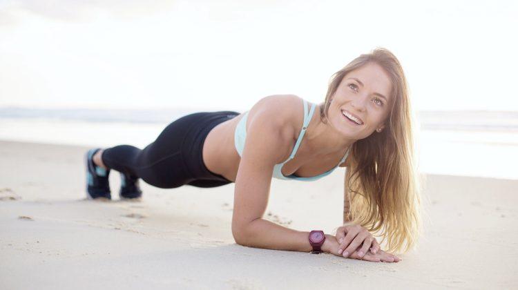 woman doing planking on the beach | Hip Bursitis Exercises For Tension Relief | hip bursitis exercises | hip bursitis stretch | Featured
