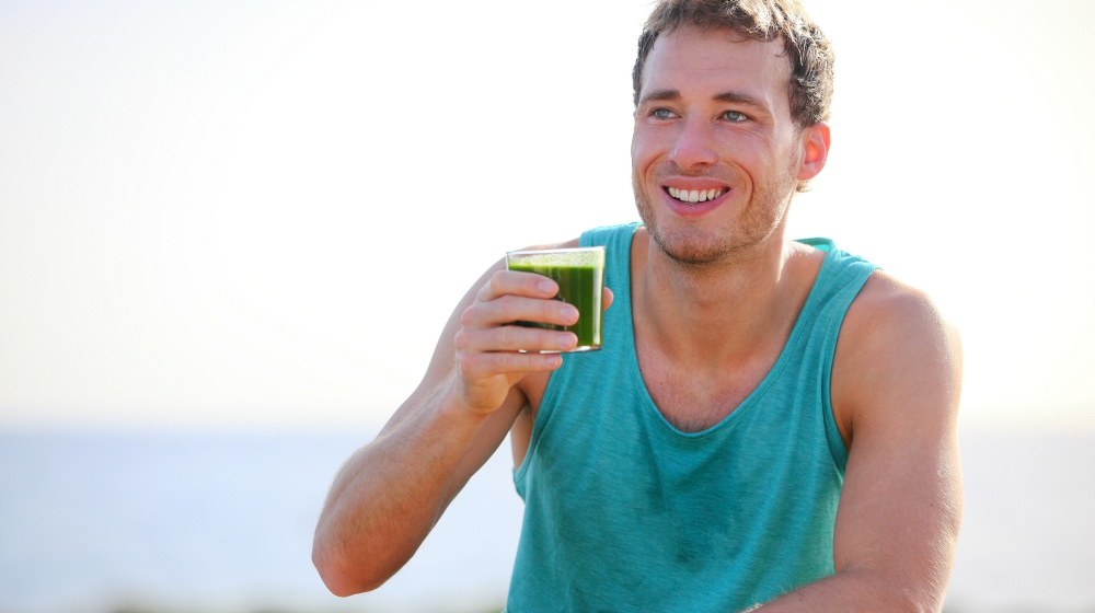 man drinking green smoothie | Anti-inflammatory Diet Meal Plan for the Holidays | anti inflammatory diet meal plan | anti-inflammatory meal plan