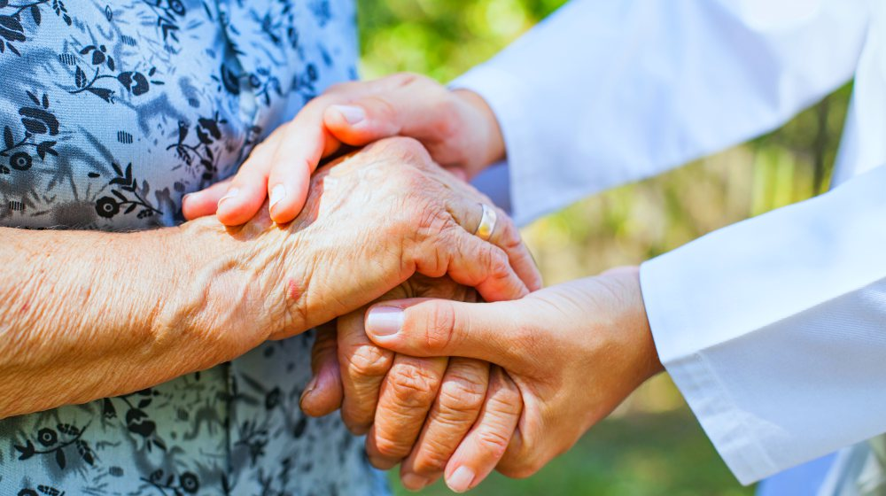 medical doctor holding senior woman's hands | The Importance of Neuromuscular Therapy For Pain Relief and Restoration | neuromuscular therapy | regenerative massage equinox