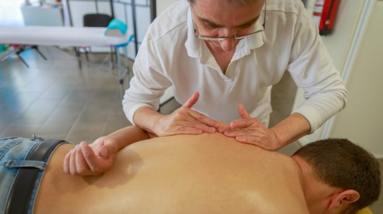 experienced therapist applies his hands patient's back | The Importance of Neuromuscular Therapy For Pain Relief and Restoration | neuromusclar therapy | performance massage | Featured