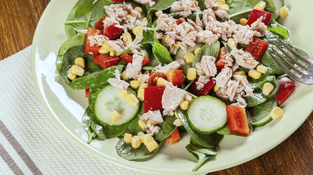 fresh spinach salad tuna cucumber corn on a plate | Anti-inflammatory Diet Meal Plan for the Holidays | anti inflammatory diet meal plan | anti inflammatory diet plan menu