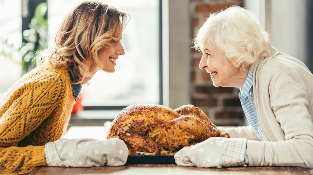 mother and daughter cooking delicious turkey | Holiday Recipes To Make With Thyroid Healing Foods | thyroid healing | thyroid healing foods