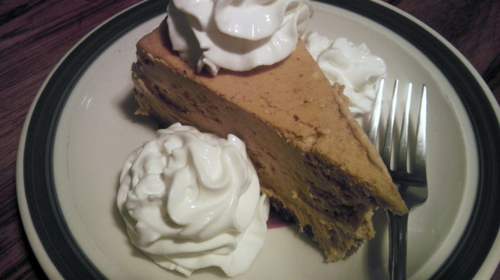 pumpkin cheesecake on plate   Planning A Keto Thanksgiving Feast? Enjoy The Holidays Without Sacrificing Your Diet   keto thanksgiving   keto thanksgiving dinner