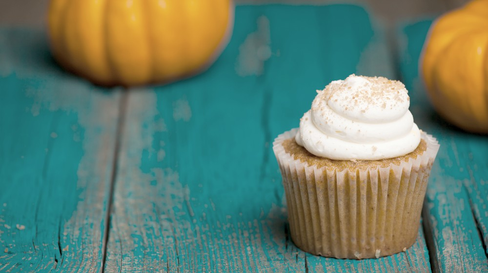 pumpkin cupcake on blue background | Planning A Keto Thanksgiving Feast? Enjoy The Holidays Without Sacrificing Your Diet | keto thanksgiving | keto thanksgiving dinner