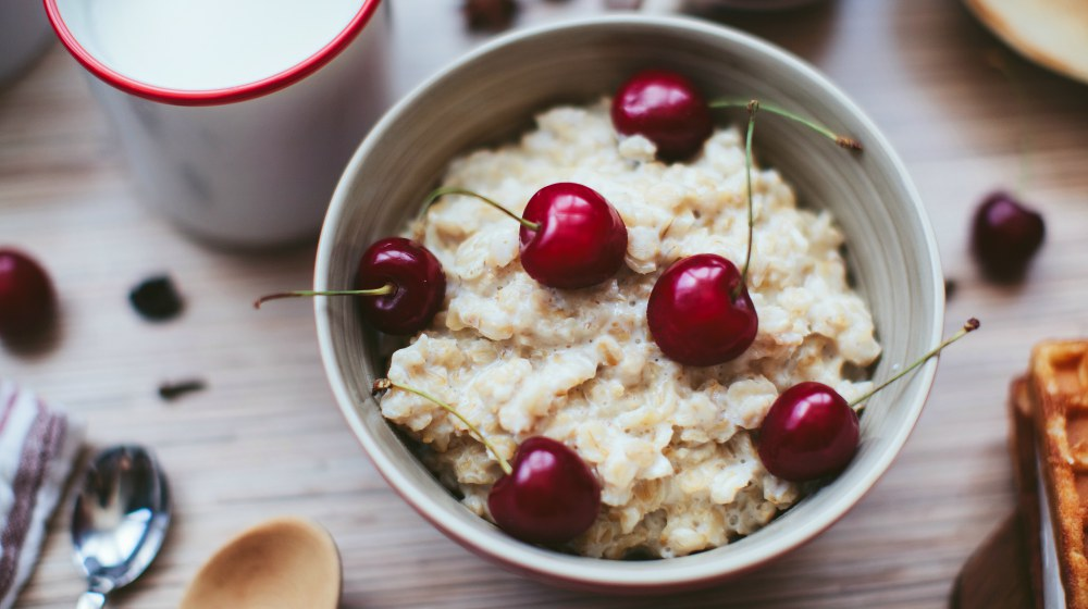 rich breakfast of porridge with cherries and pastry | Anti-inflammatory Diet Meal Plan for the Holidays | anti inflammatory diet meal plan | anti-inflammatory diet recipes