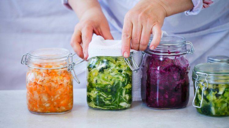 Variety of sauerkraut preserving in jars   Health Benefits Of Sauerkraut For Your Gut and Body   sauerkraut health benefits   Featured