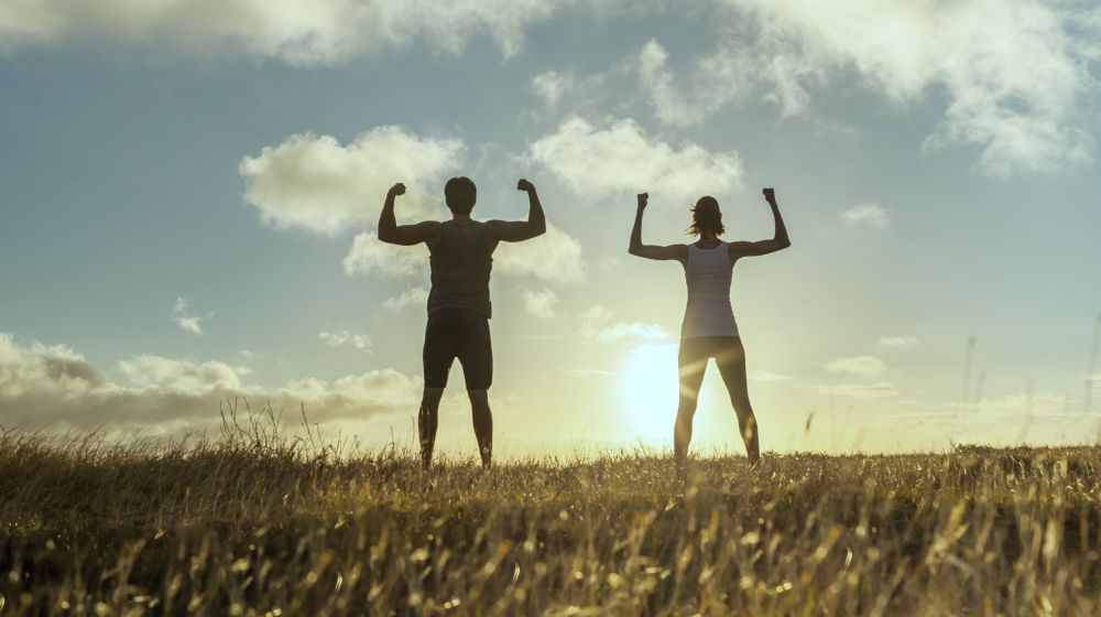 Man and woman flexing outside   Health Benefits Of Sauerkraut For Your Gut and Body   health benefits of sauerkraut